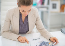 Business woman working with documents. In modern office stock image