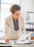 Business woman working with documents in office Stock Photography
