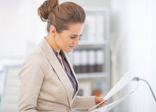 Business woman working with documents in office Stock Image