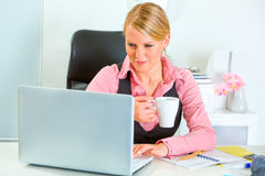 Business woman working and drinking coffee Stock Photo
