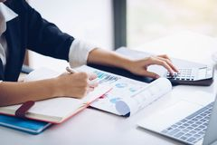 Business woman working with financial data hand using calculator and writing make note with calculate. Business financial and royalty free stock photo