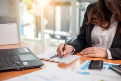 Business woman at working with financial stock image