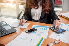 Business woman at working with financial stock photography
