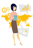 Business woman working in global business. Business woman taking part in global business. Businesswoman standing on the background of map. Global business and Stock Photo