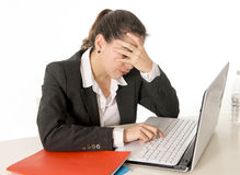 Business woman working hand covering face on laptop Royalty Free Stock Photos