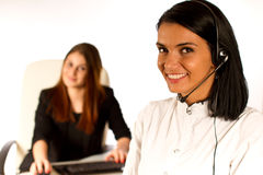 Business woman working with headset Royalty Free Stock Images