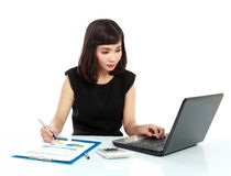 Business woman working on her desk Stock Image