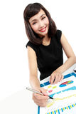 Business woman working on her desk Stock Images