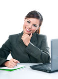 Business Woman working At Her Desk Stock Images