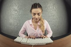 Business woman working on her keyboard, focused face stock photos