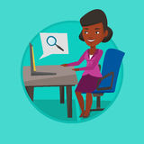 Business woman working on her laptop. African-american businesswoman working on laptop in office and searching information on internet. Internet and job search Royalty Free Stock Photo