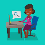 Business woman working on her laptop. An african-american young business wpman working on her laptop in office and searching information on internet. Internet Royalty Free Stock Image