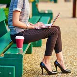 Business woman working on her laptop outdoors Royalty Free Stock Photography