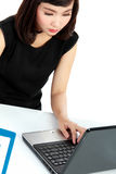 Business woman working at her office Stock Images