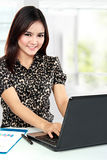 Business woman working at her office. Portrait of business woman working at her office Stock Images