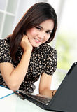 Business woman working at her office. Portrait of business woman working at her office Stock Image