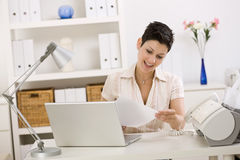 Business woman working at home. Business woman working on laptop computer at home Stock Photo