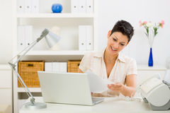 Business woman working at home royalty free stock photography