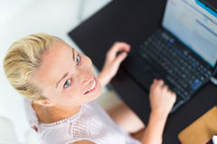Business woman working from home. Stock Images