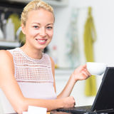 Business woman working from home. Stock Image
