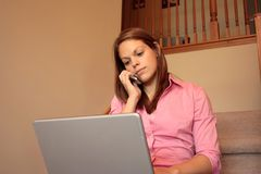Business woman working at home on her laptop Stock Images