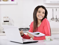 Business woman working at home. Business woman working on laptop computer at home. in the kitchen stock image