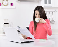 Business woman working at home. Business woman working on laptop computer at home. in the kitchen Stock Images