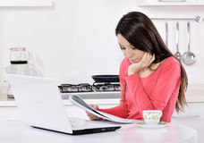 Business woman working at home. Business woman working on laptop computer at home. in the kitchen Stock Photo