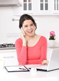 Business woman working at home. Business woman working on laptop computer at home. in the kitchen Royalty Free Stock Image
