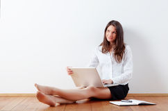 Business woman working at home with laptop. Business woman working at home with her laptop stock image