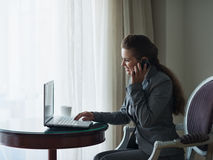 Business woman working at hotel room Stock Photos