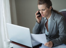 Business woman working in hotel room Stock Photo
