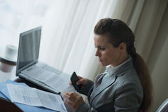 Business woman working in hotel room Stock Image