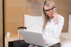 Business woman working in hotel room Royalty Free Stock Photo