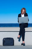 Business woman working with laptop Stock Image