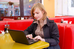 Business woman working on a laptop Stock Images