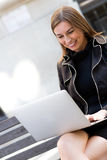Business woman working on a laptop Stock Photo