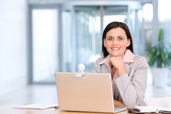 Business woman working on laptop. Attractive business woman working on laptop Royalty Free Stock Photo