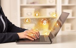 Business woman working on laptop with bitcoin link network and online concept stock images
