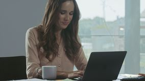 Business woman working at laptop computer. Happy person chatting on notebook. Business woman working at laptop computer in private house. Happy female person stock video footage