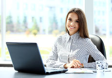 Business woman working on laptop computer stock image