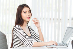 Business woman working on laptop computer at office Royalty Free Stock Photo