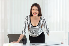 Business woman working on laptop computer at office Royalty Free Stock Images