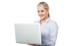 Business woman working on laptop. Corporate lady busy working on her laptop Stock Images