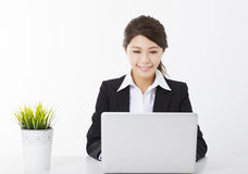 Business woman working with  laptop and green plant Stock Images