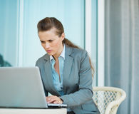 Business woman working on laptop on hotel terrace Stock Image
