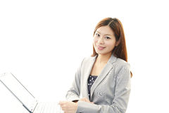 Business woman working on laptop. Isolated on white background Stock Images