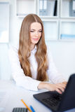 Business woman working on a laptop at office Stock Photo