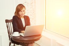 Business woman working with laptop in office. Background Royalty Free Stock Photos