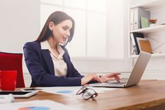 Business woman working on laptop at office Stock Photography